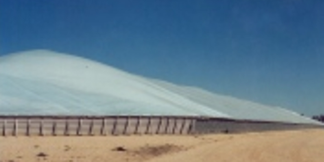 A tarpaulin covering mining product in a field